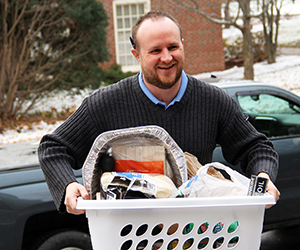 Andy Fellows, Campus Ministry carries Thanksgiving baskets for annual blessing