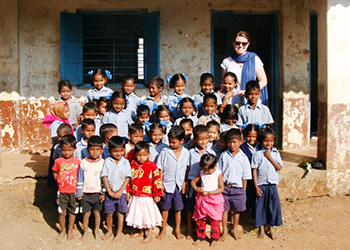 Melissa DeLury with students in Khanvel