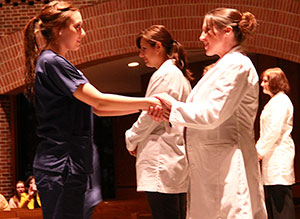 Nursing students interact with faculty members at the Blessing of the Hands ceremony. (Photo by Dao Le '15)