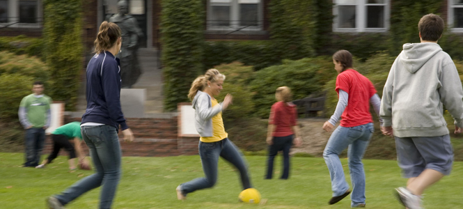 students playing soccer on the Quad