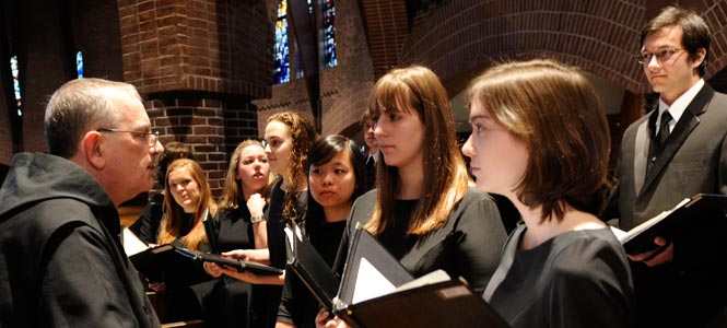 Fr. Bede confers with choir members