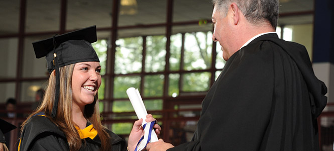 Fr. Jonathan Conferring Degree to Student
