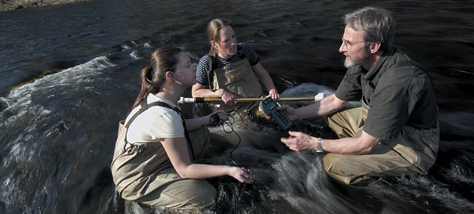 Prof. Wicklow and students gather data on river