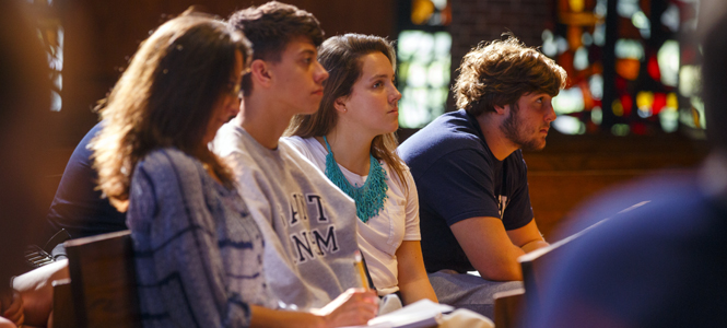 Students gather at the Saint Anselm College Abbey for class.